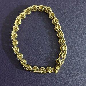 Gold bracelet with blue stones